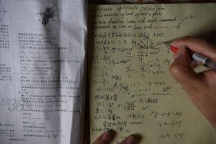 图为梁实复习高考时所做笔记.图片来源:视觉中国-高考最牛钉子户 ...