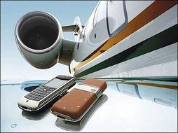 飞机上打手机只待审批 收费每分钟15元左右