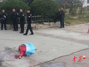 3日下午,郑州大学第五附属医院住院部楼下,一名身穿红衣的女性倒...