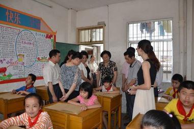 ...摄-市人大常委会对我市贯彻实施 中华人民共和国义务教育法 情况进...