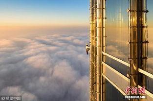...璃清洁工在迪拜哈利法塔124层外墙工作.-世界第一高楼保洁有多难 ...