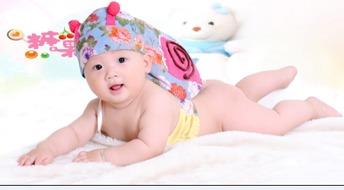 ...我去照相摄影师阿姨把我打扮成一只小蜗牛我要做一只爬的很快的小...