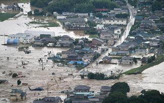鬼凿墙- 鬼怒川(图右侧)决堤现场,浊流涌入城市街道(网页截图)