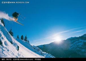 雪山上飞过的滑雪运动员图片 986781
