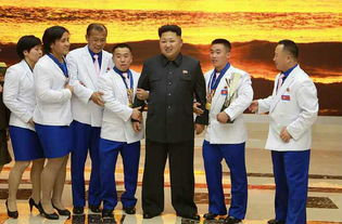 ...恩同李雪主看望朝鲜亚运代表团